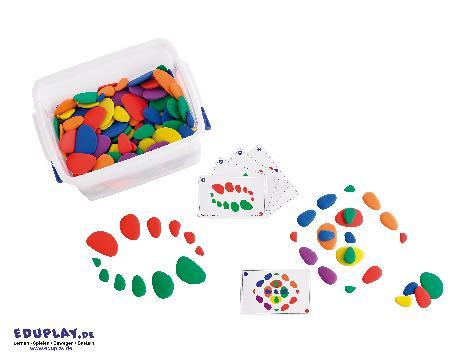 Kieselsteine Gruppenpack Zählen, sortieren, konstruieren ... Das Kieselsteine-Set ist ein Konstruktionsspiel und für erste Rechenübungen. Es unterstützt die Entwicklung der beschreibenden Sprache, feinmotorischer Fähigkeiten und der Kreativität. - Kisus e.K. - Kinder, Spiel und Spaß - Kindergarten, KITA