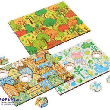 Phantasiepuzzle-Set Themen Kunterbunte Motive und Puzzleformen erkennen und zuordnen ... Bäume, Häuser, Fische und Mandala-Motive - die farbenfrohen Phantasiepuzzle animieren Kinder sofort zum Spielen. Jedes Holz-Puzzle hat 12 individuell geformte Teile, die sich nur an einer ganz bestimmten Stelle einfügen lassen. Die Kinder können sich beim Puzzlen an den Motiven und an den Formen der Puzzleteile bzw. der Aussparungen in den Puzzleplatten orientieren. Zwei der Mandala-Puzzle (mit einfarbigem Hintergrund) sind nur über die Teile-Form zusammenzufügen. Durch die Aussparungen an der Unterseite der Puzzleplatte lassen sich die Einzelteile ganz leicht entnehmen. Die Phantasiepuzzle fördern Konzentration, Wahrnehmung und Denkvermögen. Anhand der verschiedenen Schwierigkeitsgrade können Pädagogen den Entwicklungsstand der Kinder einschätzen.